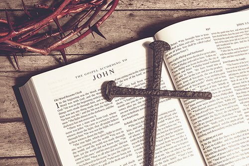The crown of thorns, a bible and a cross.