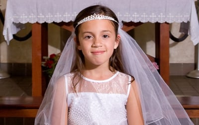 A young girl prepared to receive her First Communion.