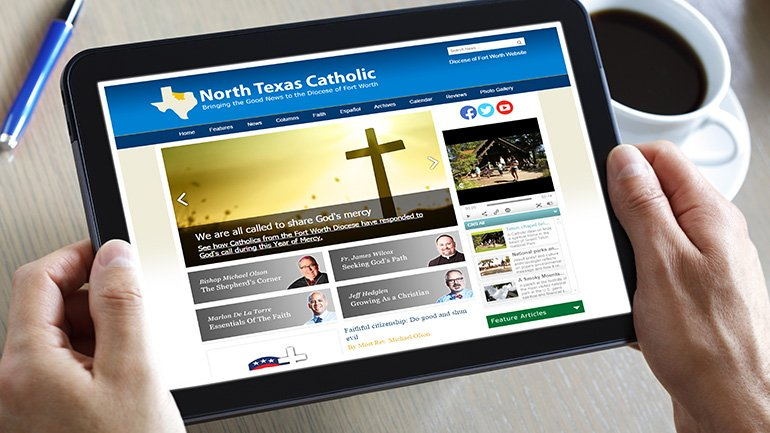 A person holding a tablet reads the North Texas Catholic newsmagazine.