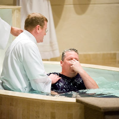 A candidate is baptized during the Easter Vigil Mass.