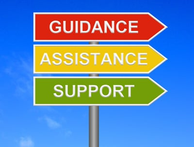 A signpost with the words: Guidance, Assistance and Support