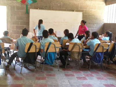A teacher instructs a classroom of students.